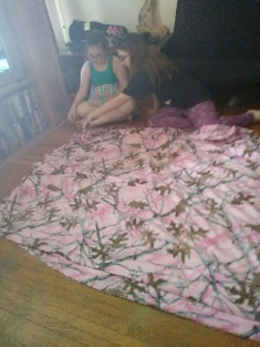 Friends daughters working on blankets